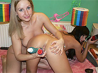 Two cute teenagers masturbate with toys